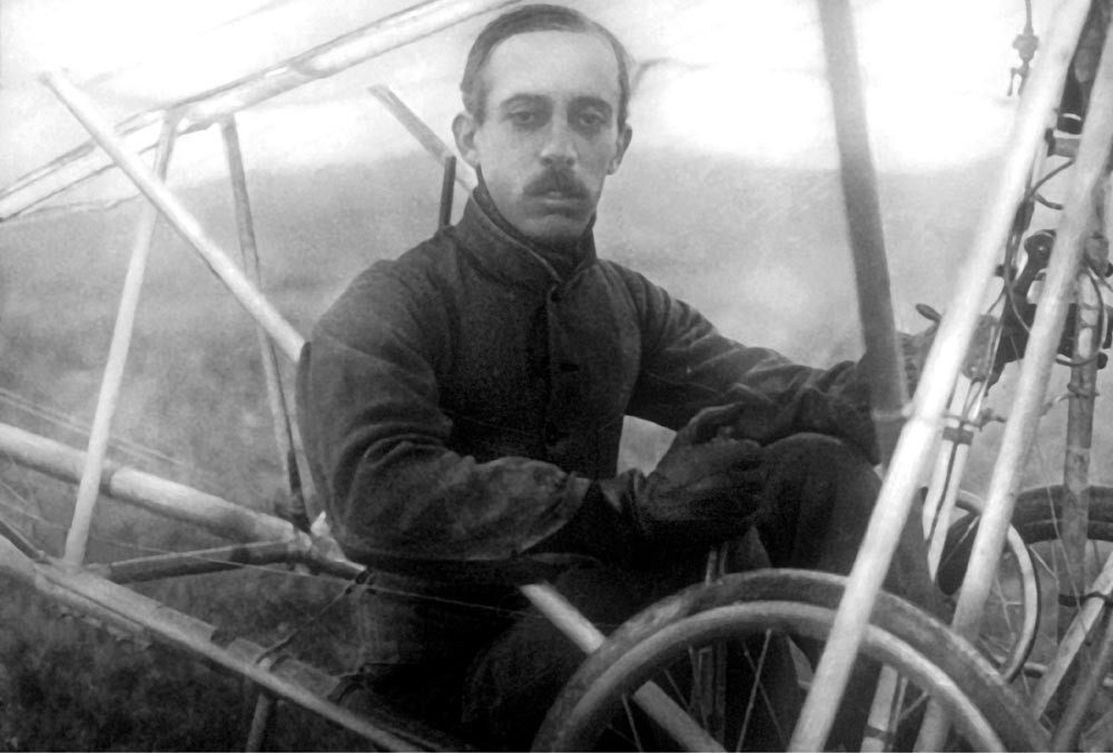 c. 1909. Alberto Santos-Dumont, the renowned aeronaut and first person to fly outside the United States, sits in his Demoiselle monoplane. Credit: Archive Photos.